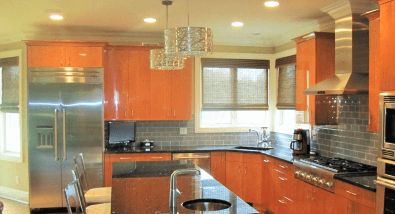 Shiny Orange Kitchen with Mini Sink in Middle