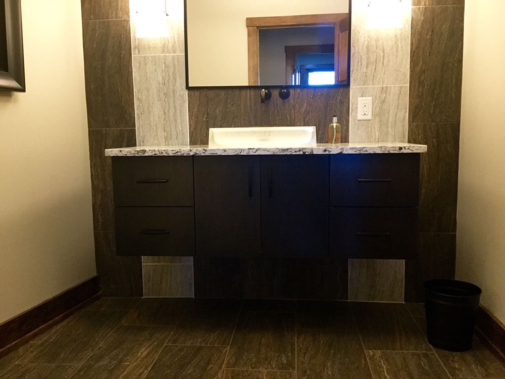 Modern Bathroom with Black Cabinets Soap