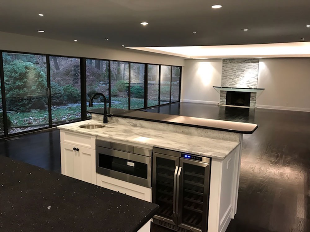 Modern Kitchen Sink and Wine Cellar in Middle