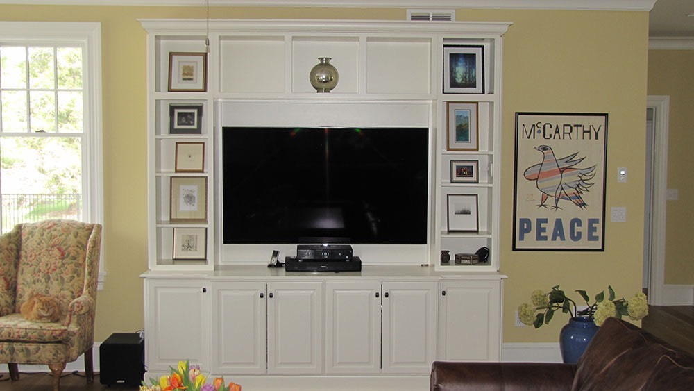 White Cabinets with TV Peace Room