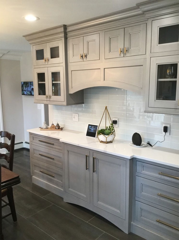 Glass kitchen cabinet with speakers and iPad on top