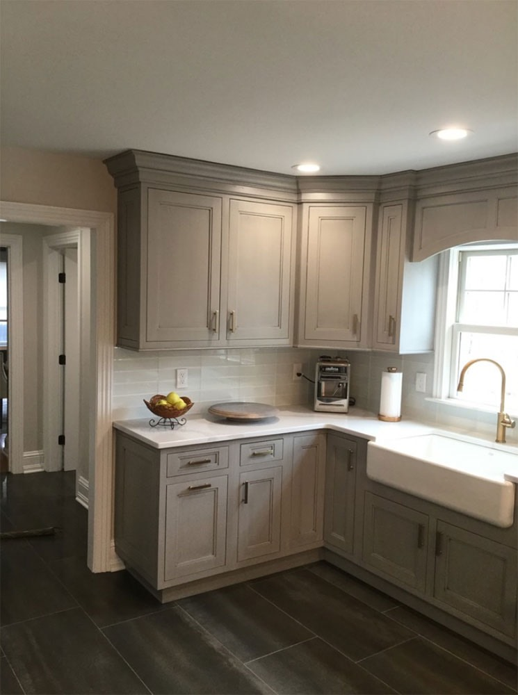 white gray cabinets with lemons on counter