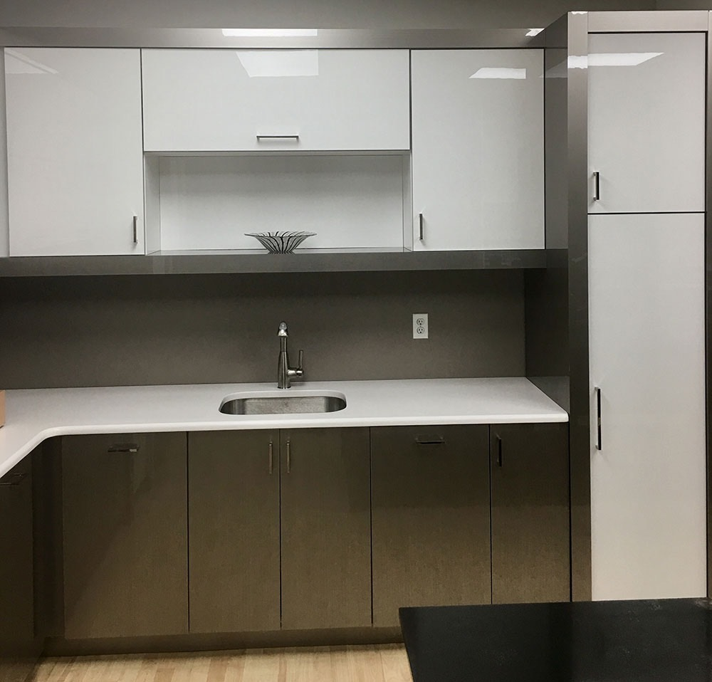 shiny white kitchen cabinet with sink and storage space
