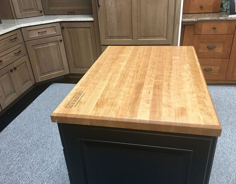 table in middle of kitchen